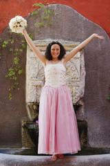 Hispanic girl wearing Quinceanera dress