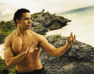 Mixed Race man practicing Tai Chi