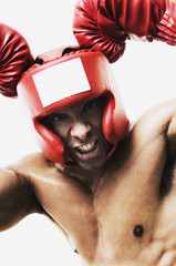 Mixed Race man wearing boxing gear