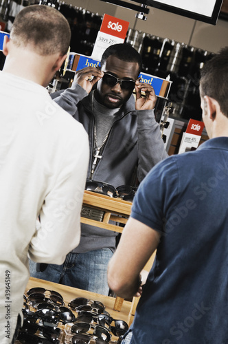African man shopping for sunglasses