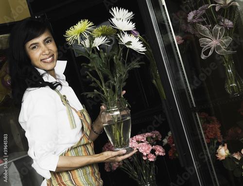 African sales clerk in florist shop