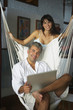 South American couple with laptop