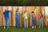 Fototapety Mixed Race family painting fence