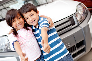 Happy kids buying a car