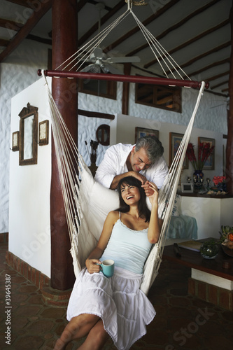 South American man smiling at wife