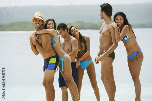 South American couples at beach