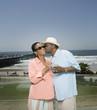 Senior African man kissing wife on cheek