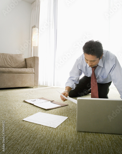 Asian businessman reading paperwork