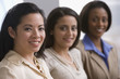 Multi-ethnic businesswomen sitting in row