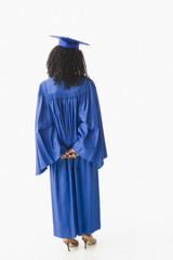 African American woman wearing graduation cap and gown