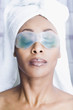 African American woman wearing gel eye mask