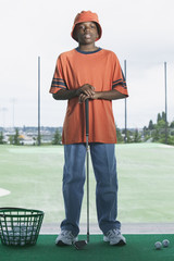 Portrait of boy golfing