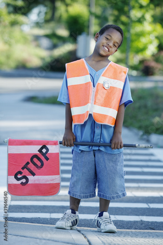 Portrait of boy on cross walk duty