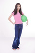 Ten year old Asian girl holding green ball
