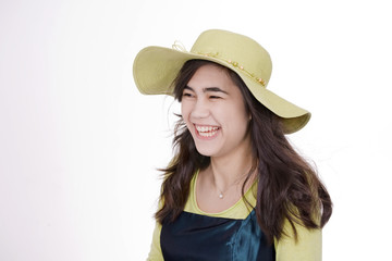 Smiling biracial teen girl in green dress and  hat
