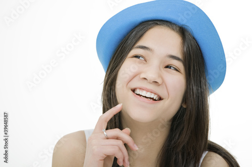 Beautiful young teen girl with blue hat, with thoughtful look