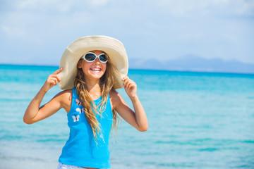 Girl in big hat relax ocean background