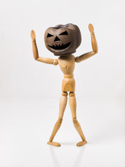 Pumpkin head doll and hands up
