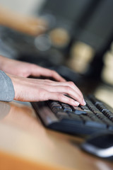 Closeup of a business woman typing on a laptop