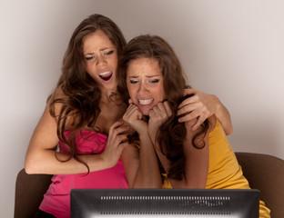 Gemini sisters watching a horror movie on TV
