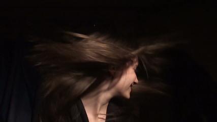 Beautiful girl shakes her hair