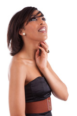 Thoughtful african woman with elegant black dress