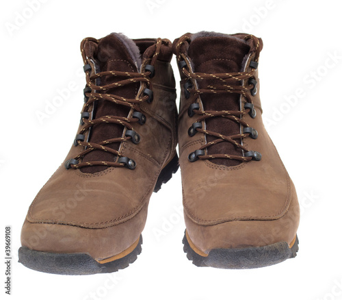 A pair of new boots on white background