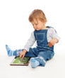 Young kid playing with tablet pc