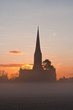 Salisbury cathedral on a misty morning