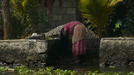 Hand-wash in a river, Kerala, India