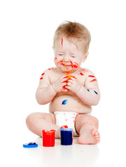 Funny dirty child with paints. Isolated on white background