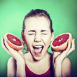 crazy girl with a grapefruit