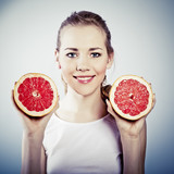 portrait of young attractive woman with grapefruit