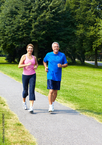 Seniors couple jogging.