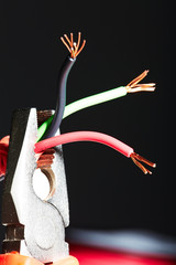 Pliers with electrical cables.