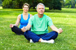 Senior couple doing yoga.