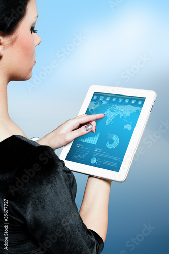 Cute brunette using interface of new touch pad device