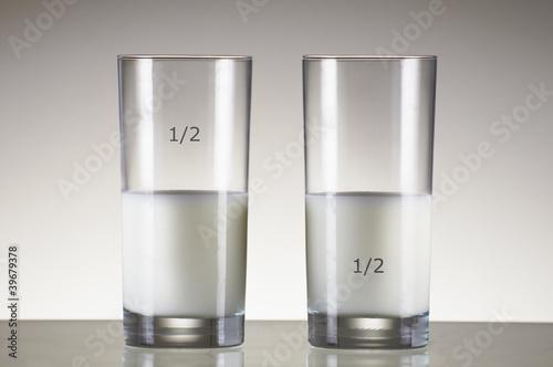 Leinwandbild Motiv glas of milk half full