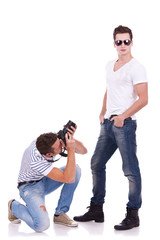 young man wearing sunglasses being photographed