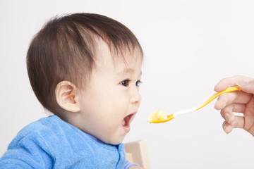 Baby eating with spoon