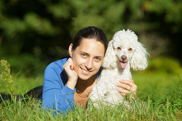 Beautiful young woman and happy dog