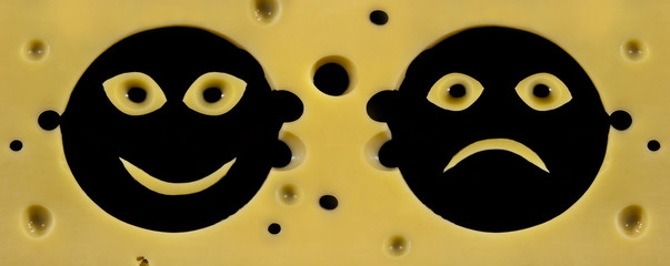 Smile faces positive and negative in hard cheese texture