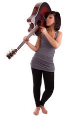Young black woman playing  guitar