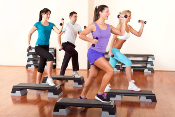 step aerobics with dumbbells