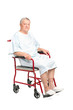 A senior patient seated in a wheelchair posing