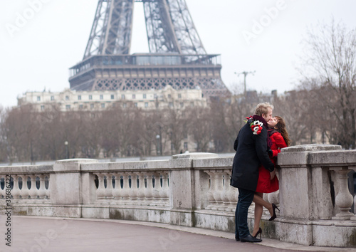 Romantic couple in love in Paris, near the Eiffel tower