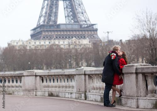 Romantic couple in love in Paris, near the Eiffel tower