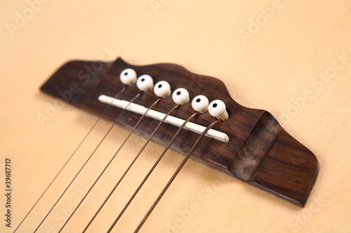 Guitar bridge and strings