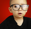portrait of kid wearing glasses over red background