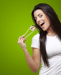 woman holding sushi